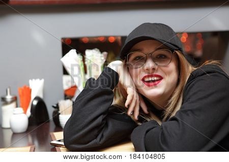 Happy Teenager Girl In Cafe