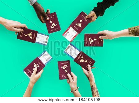 Group of hands holding passport in aerial view