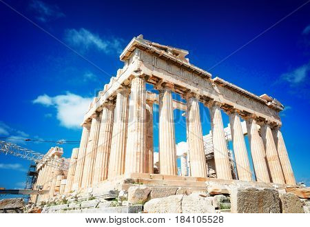 Parthenon temple over bright blue sky background, Acropolis hill, Athens Greecer, retro toned