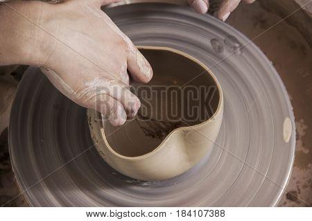 Close up of Ceramist hands at work in her workshop