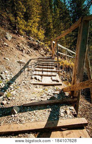 Old Wooden Stairway in Kazakhstan Mountains Background