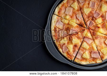 Pizza Hawaii On Dark Stone Background.