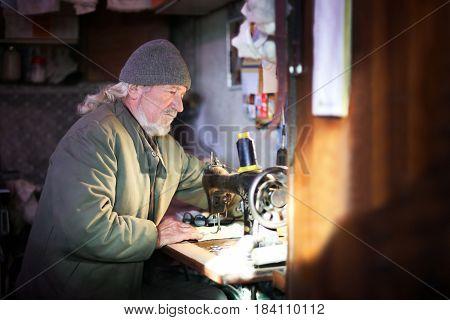 Man Sewing At Home