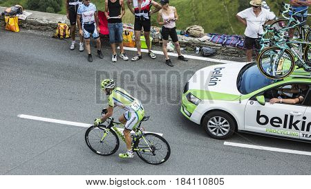 Col de PeyresourdeFrance- July 23 2014: The French cyclist Jean-Marc Marino (Team Cannondale) climbing the road to Col de Peyresourde in Pyrenees Mountains during the stage 17 of Le Tour de France on 23 July 2014.
