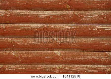 brown background of wooden logs of a private house