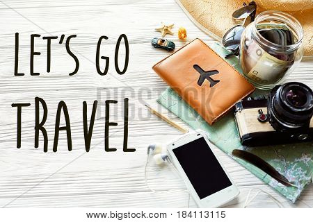 Travel. Let's Go Travel Text Sign Concept . Summer Travel Wanderlust. Map Camera Sunglasses Passport