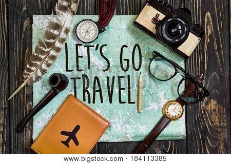 Travel. Let's Go Travel Text Sign Concept On Map, Wanderlust Hipster Flat Lay. Passport Compass And