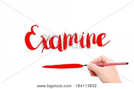 The word of Examine written by hand on a white background