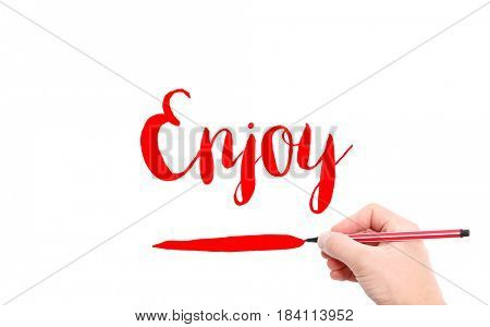 The word of Enjoy written by hand on a white background