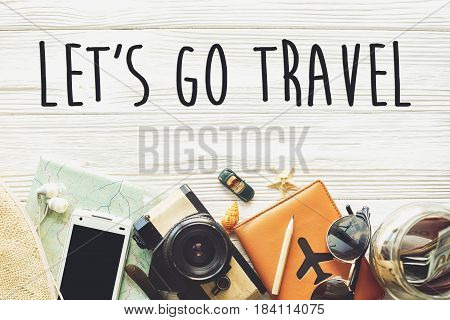 Travel. Let's Go Travel Text Sign Concept, Wanderlust Vacation Background Flat Lay. Camera Sunglasse