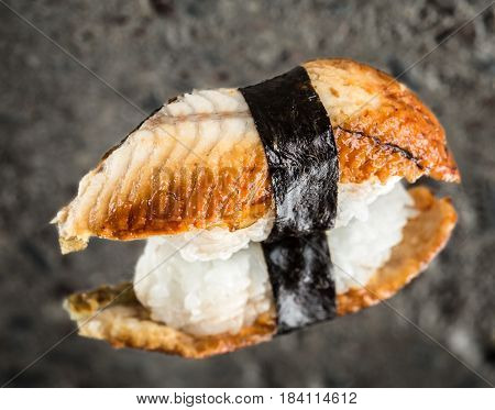 Nigiri sushi with eel over concrete background