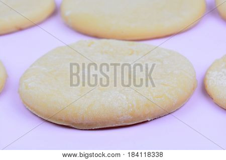 Dough on pink background close up c