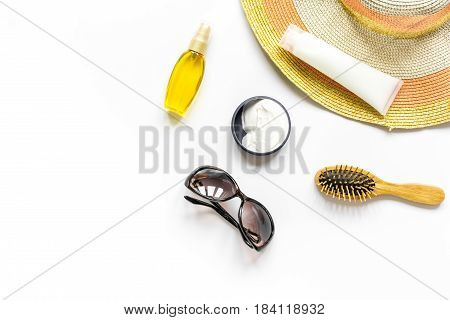 Sun glasses, protiction cream, hat, comb for beach rest on white background top view mock-up
