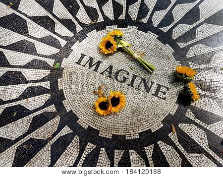NEW YORK USA - September 11 2016: The Imagine mosaic with sunflowers at Strawberry Fields in Central Park Manhattan