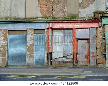 Derelict and boarded up shops in Liverpool UK