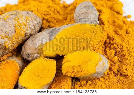 Turmeric roots with turmeric powder. Spice symbol. For food design, restaurant, store, market, health care products. Can be used as logo, price tag, label