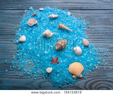 Sea coarse salt and sea shell on wooden.