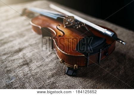 Violin, fiddlestick and bowtie, canvas background
