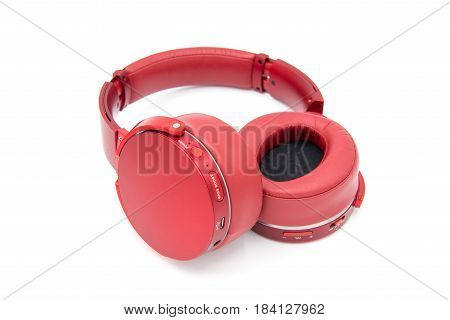 Red Over-the-head Headphones On A White Background