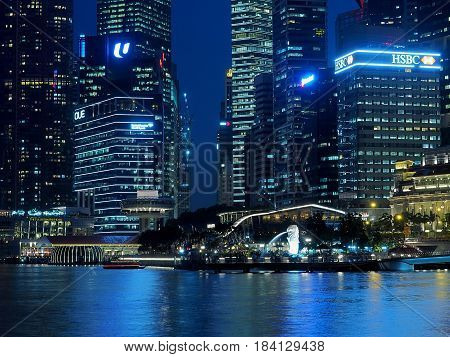 Skyscrapers of Merlion Park. Singapore, Asia - June 05, 2016 Office buildings, hotels, banks and the Merlion national symbol of Singapore gushing in the evening scenery of Merlion Park in Singapore