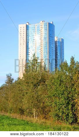 Modern building on the outskirts of St. Petersburg at summer sunny day Russia.
