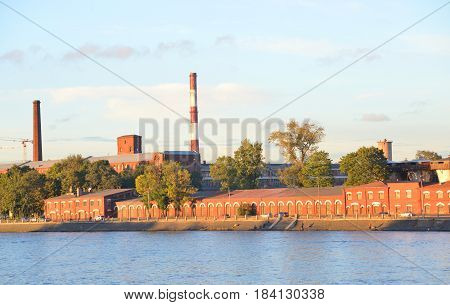 The old factory building on the banks of the Neva River in St.Petersburg at evening Russia.