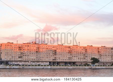 Embankment of Neva river on the outskirts of St. Petersburg at sunset Russia.