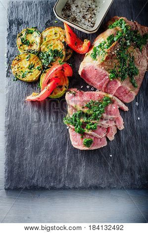 Roast Beef dinner with roasted zucchini, pepper and salsa verde