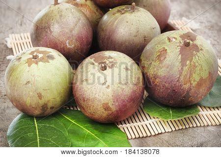 Ripe purple star apple fruit on wooden.