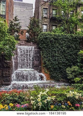 A waterfall among the apartment buildings in this small park on the East Side of Manhattan.