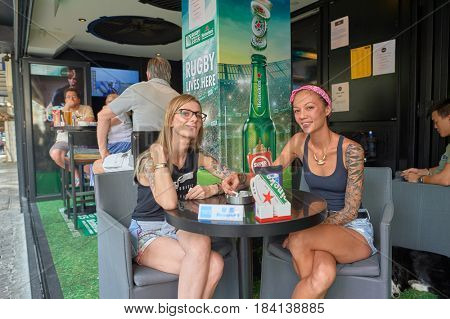 HONG KONG - OCTOBER 25, 2015: two women at a bar in Kennedy Town. Kennedy Town is at the western end of Sai Wan on Hong Kong Island