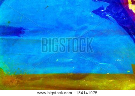 Abstract background image. Blue, Gold and Green cellophane gel lays over a white table cloth for a unique colored and textured abstract background. Room for text or images.