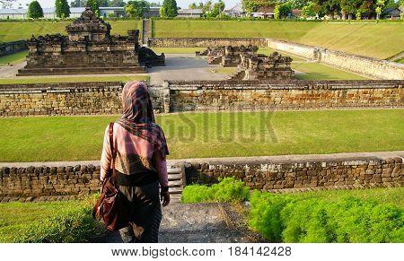 A tourist visiting Sambisari Temple in Yogyakarta, Indonesia