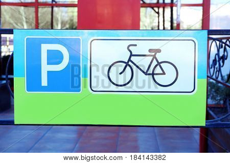 Sign denoting place for bicycles parking outdoors, closeup