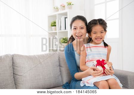Girl Children And Mother Hold Mother's Day Gift