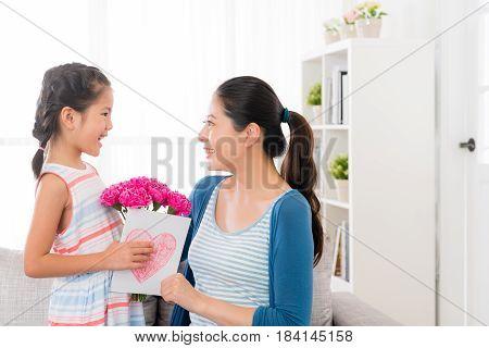 Little Girl Prepare A Pink Carnation Bouquet