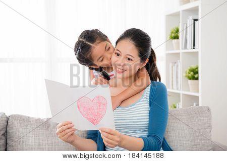 Cute Little Daughter Kiss The Woman's Cheek