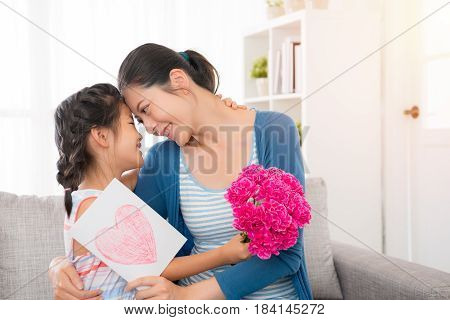 Young Asian Mother Accept The Little Daughter Card