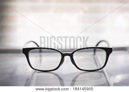 close up of beautiful black frame glasses with sunlight in the morning.