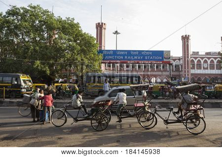 DELHI INDIA-JUN 10 : rickshaw and traffic in front of old delhi railway station of delhi on june 10 2015 india. rickshaw is three wheeler bike taxi in any local area of delhi