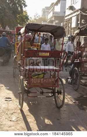 DELHI INDIA - MAR 23 : rickshaw in jam traffic at chandni chowk in old Delhi of Delhi on march 23 2015 india. rickshaw is three wheeler taxi for local area of Delhi