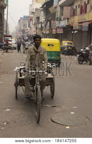 DELHI INDIA - MAR 29 : unidentified india people cycling at main bazar paharganj. this area is tourist hub in delhi on march 29 2015 india