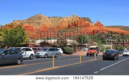 View of Sedona Arizona city center and downtown with backdrop of red rocks