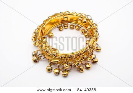 Closeup To Golden Old Small Bell Bangle In Indian Style, Isolated