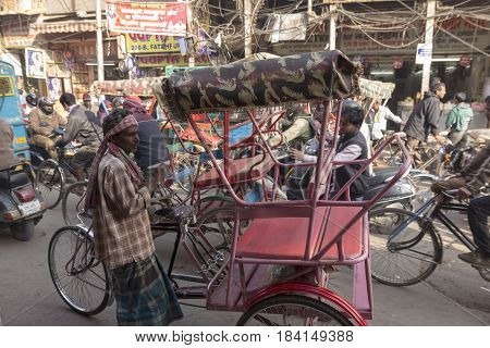 DELHI INDIA - DEC 20 : rickshaw driver looking for passengers in rush hour in chandni chowk in old delhi this is famous place of delhi on december 20 2014 india