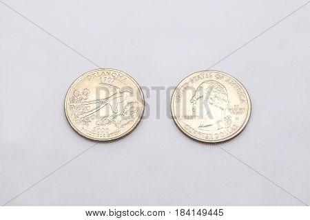 Closeup To Oklahoma State Symbol On Quarter Dollar Coin On White Background