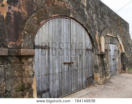 Old doors at the El Morro Fort, San Juan Puerto Rico Strong old doors at the very ground levels Fort San Felipe del Morro, Puerto Rico