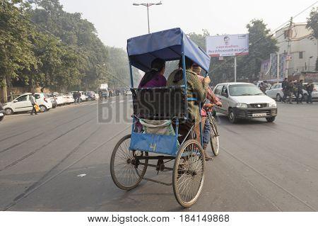 DELHI INDIA - DEC 28 : transport passengers by rickshaw at karol bagh. rickshaw is also main transportation in small area of delhi on december 28 2014 india