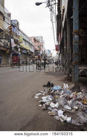 DELHI INDIA - MAR 15 : morning scene of rubbish and dirtiness on road in chawri bazar in old delhi of delhi on march 15 2015 india