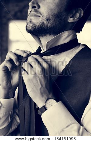 Handsome Groom Dressing Up for Wedding Ceremony